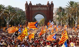 People wave pro-independence Catalan flags as they gather during a pro-independence demonstration in Barcelona to demand their region break away from Spain.