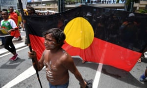 A young Aboriginal boy carries a spear during an Invasion Day march in Brisbane on 26 January. An Amnesty International report has criticised Australia for its continued over-incarceration of Indigenous people.
