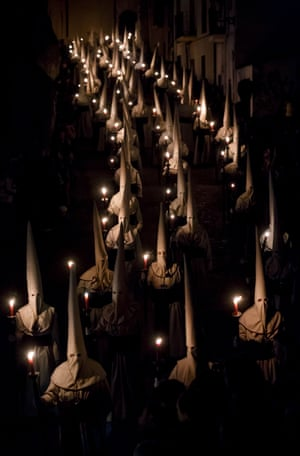 Penitents of the Jesus Yacente brotherhood parade with candles in Zamora, Castile and León