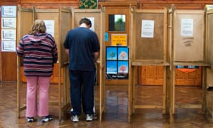 Voting in local elections at polling station in Haringey, London