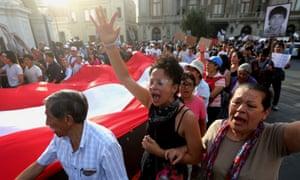 Protesters march in Lima after the president, Pedro Pablo Kuczynski, pardoned his predecessor Alberto Fujimori.