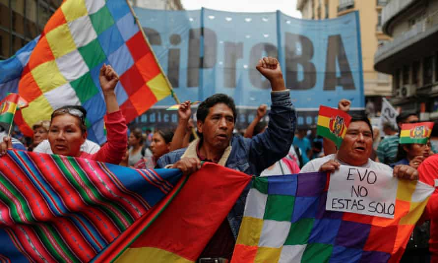 People take part in a demonstration in support of Evo Morales