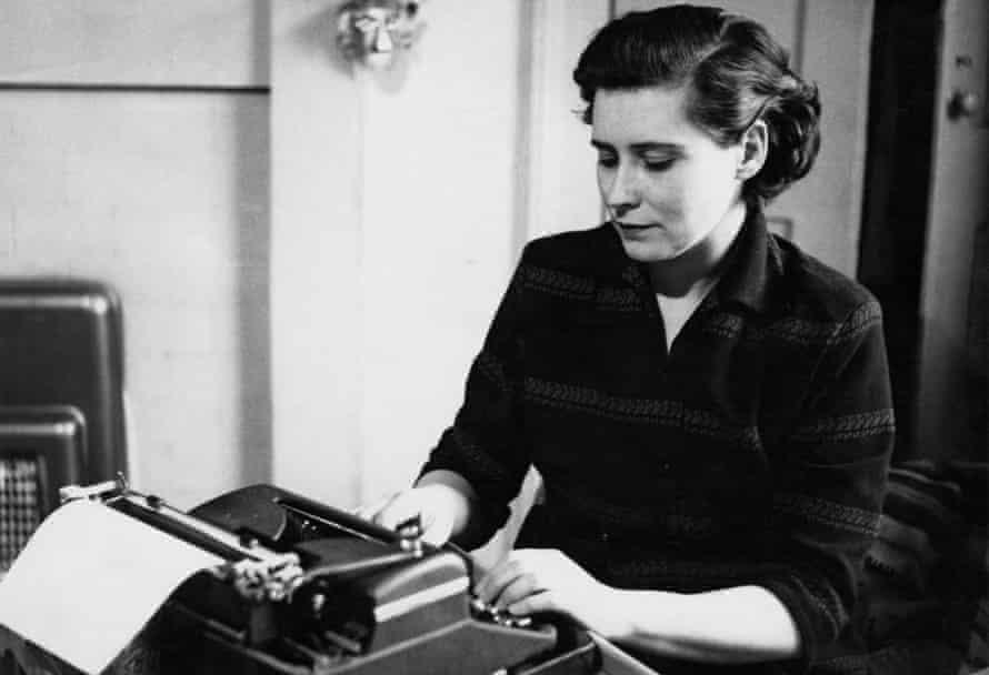 Doris Lessing working at a typewriter, circa 1950.