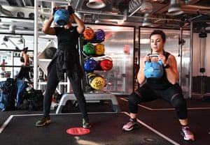 Weightlifters lift kettlebell weights