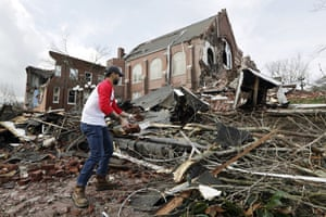 Sumant Joshi helps to clean up rubble at the East End United Methodist Church after it was heavily damaged.