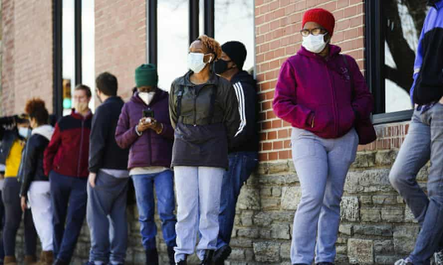 People wait in line to receive coronavirus vaccines at a site in Philadelphia on Monday.