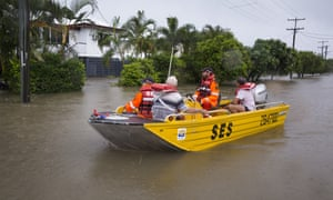SES volunteers are seen rescuing residents in Rosslea, Townsville