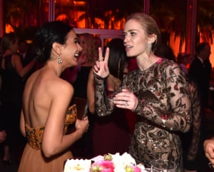 Emmanuelle Chriqui and Emily Blunt chat during the Vanity Fair party