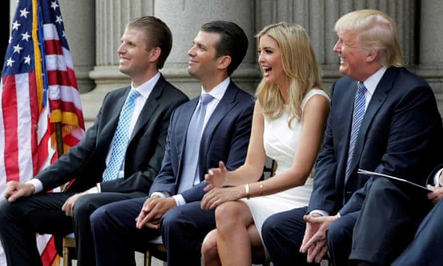 Trump with sons Eric and Donald Jr and daughter Ivanka at the ground-breaking of the Trump hotel in 2014. The hotel became a magnet for controversy.