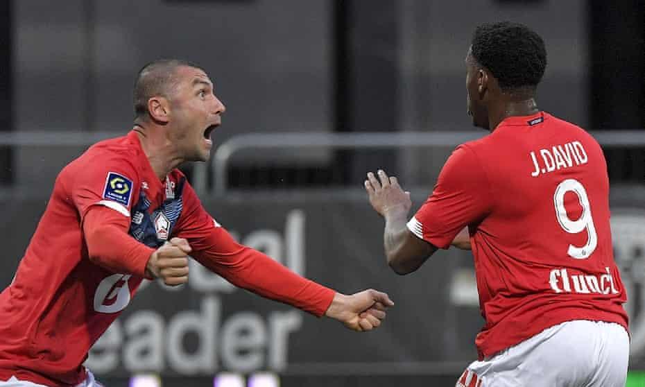 Jonathan David and Burak Yilmaz celebrate Lille's goal against Angers.