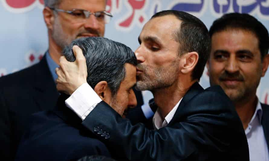 Iranian candidate Hamid Baghaei kisses former boss Ahmadinejad after registering his candidacy.