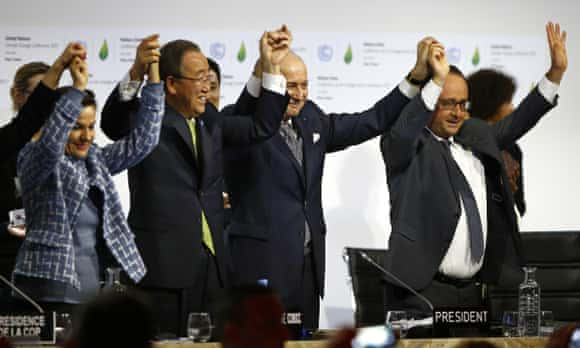 The French president and foreign minister, along with the UN secretary general and UN climate chief, celebrate agreeing the Paris climate change deal.