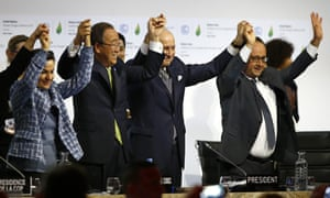 French president Francois Hollande, president of the COP21 Laurent Fabius, United Nations climate chief Christiana Figueres and United Nations Secretary General Ban Ki-moon hold their hands up in celebration after the final conference at the COP21, the United Nations conference on climate change.