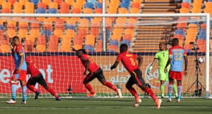 Emmanuel Okwi wheels away in celebration after doubling Uganda's lead.