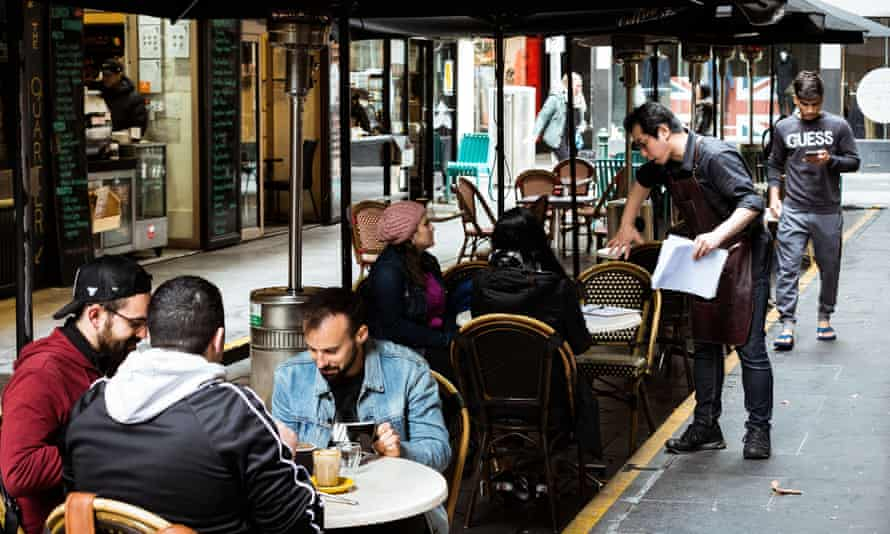 Customers sit outside at a cafe in Melbourne's Degraves Street