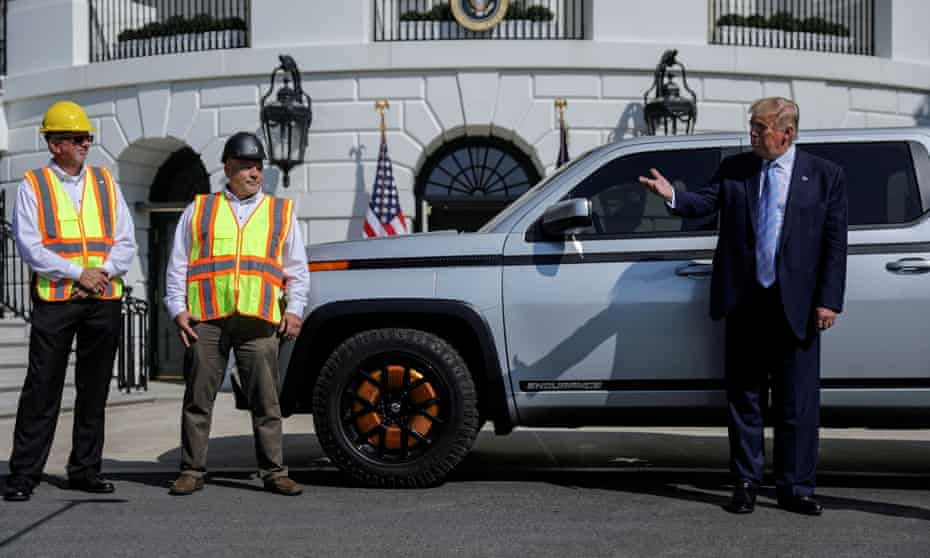 Donald Trump with two Lordstown Motors employees at the White House last year.