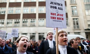 Barristers in their wigs and robes shout slogans outside the Department for Justice during a protest against cuts to the legal aid budget in central London in 2014.