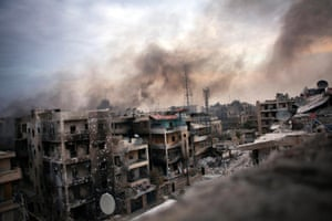 Smoke billows over shelled and destroyed buildings in Saif al-Dawla district, Aleppo, Syria. The Syrian army continued its shelling in the city and brought in reinforcements to try to put an end to the rebels' resistance. 2 October 2012.