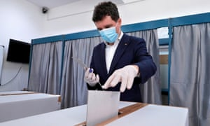 A candidate to be Bucharest's city mayor, Nicusor Dan, casts his ballot at the Gymnasium School Nr. 279's polling station in Bucharest, Romania, 27 September 2020.