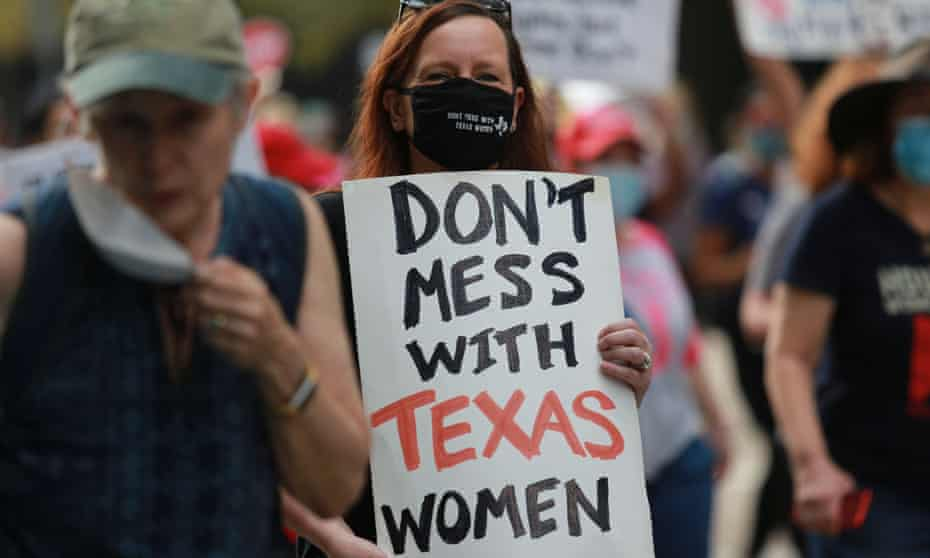 A woman marches in protest of Texas' SB8, a controversial bill that bans abortions at about six weeks of pregnancy.