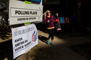 Arlington, Virginia A woman leaves Fire Station 10 after voting in the 2016 election