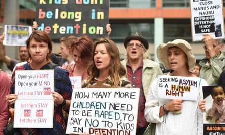 Hundreds of protesters hold a rally outside the Department of Immigration offices in Sydney to call for the closure of the Nauru and Manus detention centres.