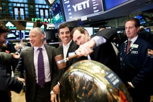 David Schnadig (L), a managing partner at Cortec Group, Roy Seiders (2-L), one of Yeti's founders, and Yeti CEO Matt Reintjes (2-R) ring a ceremonial bell during Yeti's initial public offering at the New York Stock Exchange