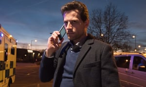 Ioan Gruffud as the surgeon in Liar, standing making a phone call in a hospital car park.