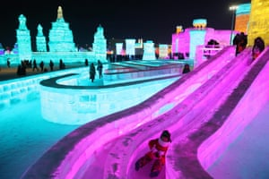 A child enjoys a slide at the ice festival in Harbin city, in China's northern Heilongjiang province, on Thursday. About 180,000 cubic metres of ice and 150,000 cubic metres of snow were used to build the 800,000-square-metre Harbin ice and snow world where the festival will last for about three months.