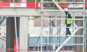 Construction workers continue work on a building site in Somerset during the coronavirus outbreak.