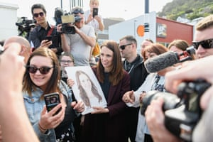 Jacinda Ardern receives a gift from a member of the public  in the street