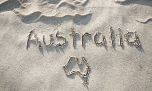 Australia written in the sand with map of Australia