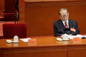 Former Chinese president Jiang Zemin attends the opening session at the Great Hall of the People