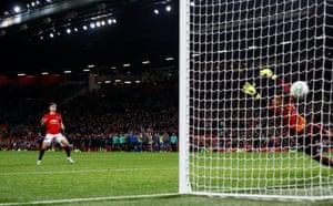 Manchester United's Daniel James scores the decisive penalty.