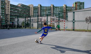Young Kosovans playing football in Pristina's Dardania neighbourhood.