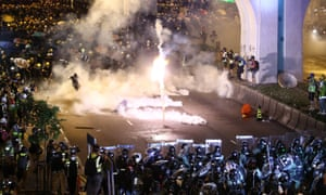 Protesters are engulfed by teargas during a confrontation with riot police in Hong Kong on Sunday.