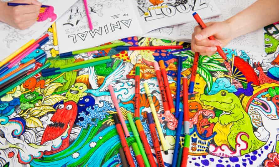 Staff at Michael O Mara Books colouring in adult colouring books
