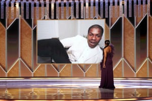 Actor John Boyega accepts the best supporting actor - TV award for Small Axe from Angela Bassett