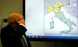 Boris Johnson views a map of the spread of Covid-19 in Italy on a visit to Public Health England. The number of confirmed cases in the UK leapt to 35 after 12 new patients were identified in England