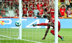 Sadio Mané stabs home Liverpool's first goal against Chelsea.
