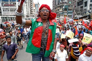 Dhaka, Bangladesh. A demonstrator wears chains around his neck as several organisations take part in rallies in the city