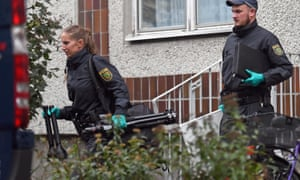 German police exit an apartment complex in Leipzig