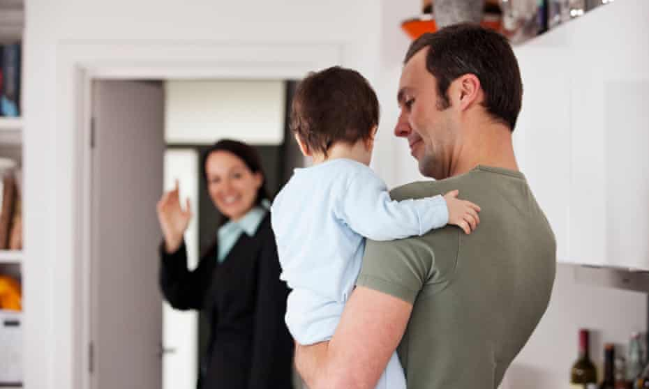 A mother leaving for work, waving goodbye to her partner and baby sonCPBNMM A mother leaving for work, waving goodbye to her partner and baby son