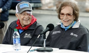 Jimmy Carter and Rosalynn Carter answer questions at a Habitat for Humanity project, in October last year.