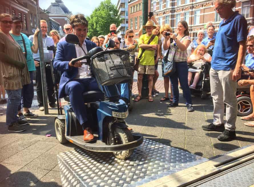 Paul Depla, the mayor of Breda, tries a ramp designed to make the city accessible to people who use wheelchairs.