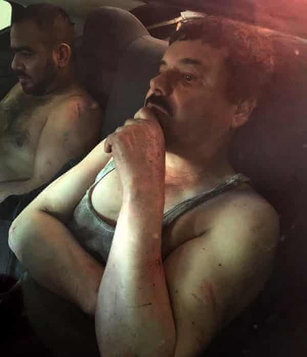 Joaquin 'El Chapo' Guzman in a vehicle after he was recaptured in the city of Los Mochis, Sinaloa state in north-west Mexico on Friday.