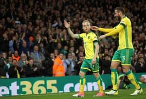 Alex Pritchard celebrates with team-mate Mitchell Dijks after scoring.