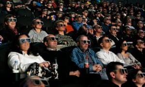 Cinema audience wearing 3D glasses