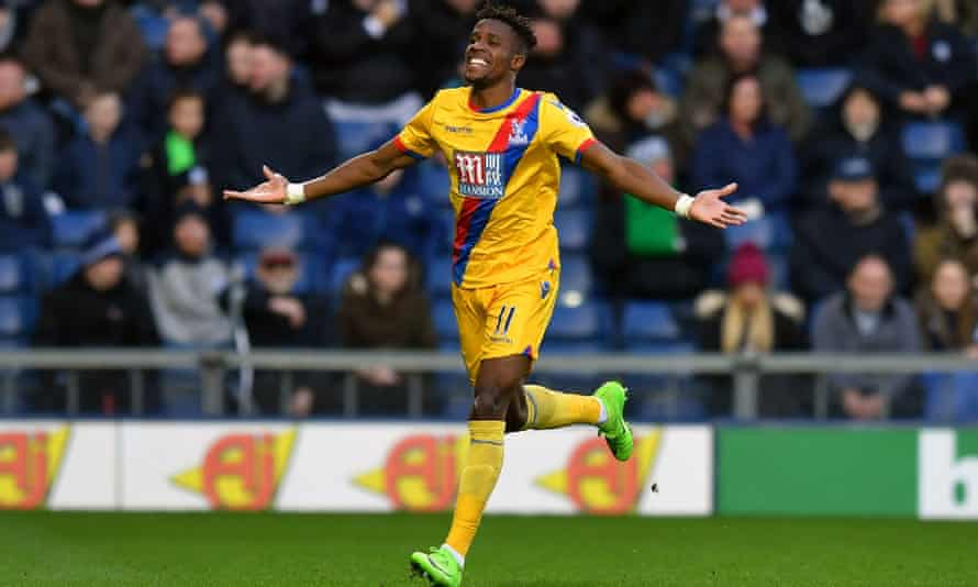 Wilfried Zaha celebrates scoring the opening goal for Crystal Palace against West Brom.