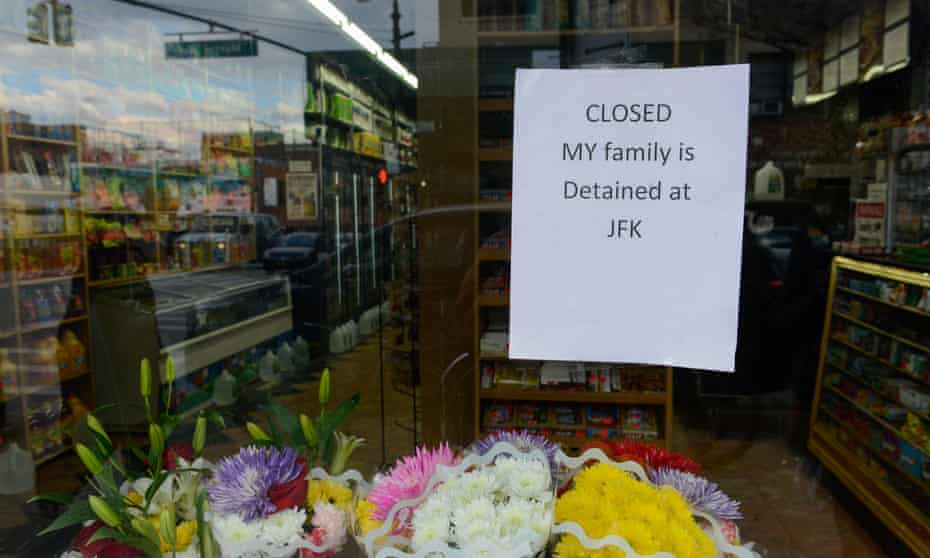 A Yemeni bodega explains why it is closed before a protest against Donald Trump's travel ban, in the Brooklyn borough of New York City on Thursday.